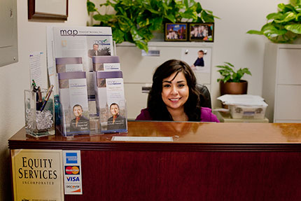 The reception desk with small business planning materials